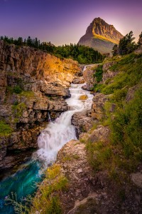 Swiftcurrent Falls at sunset with Grinnel Peak in the background in Glacier Nationalk Park Montana. Part of the Darkroom Gallery Exhibit The Natural Realm.