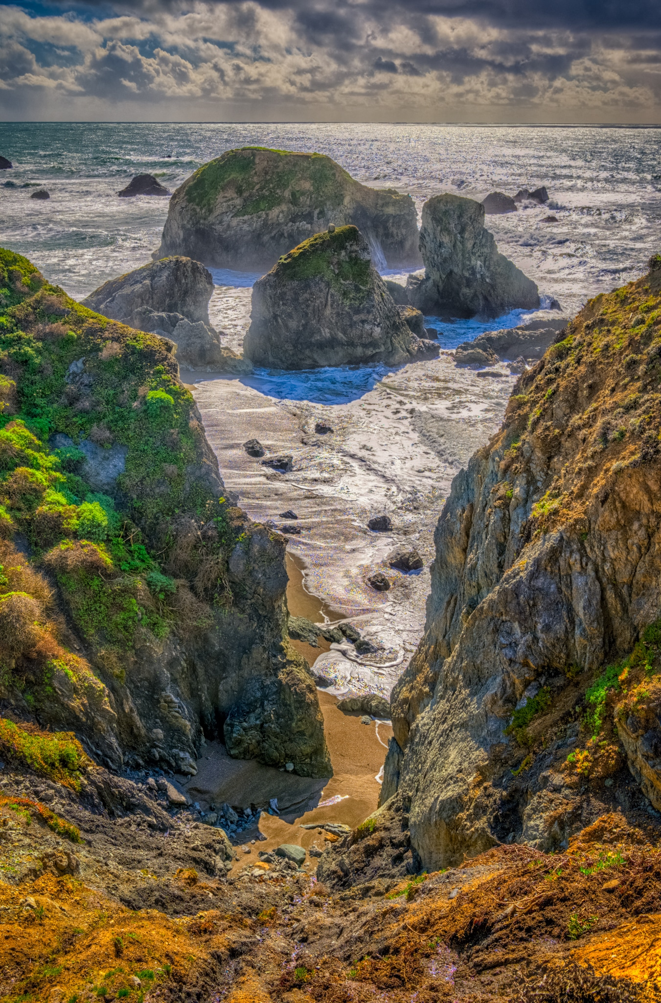 Sea Stacks and boulder add drama to the coastline along Duncan's Landing, off CA Highway 1 between Bodega Bay and Jenner, California.