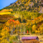 A farm building is just visible along the Last Dollar Road between Telluride and Ridgway, Colorado.