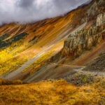 The rust and tan rocks contrast with the golden aspens along Ophir Pass Road, between US 550 and Telluride, Colorado.