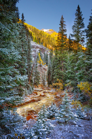 A view of a mountain stream taken after a dusting of snow along the Million Dollar Highway outside Ouray, Colorado.