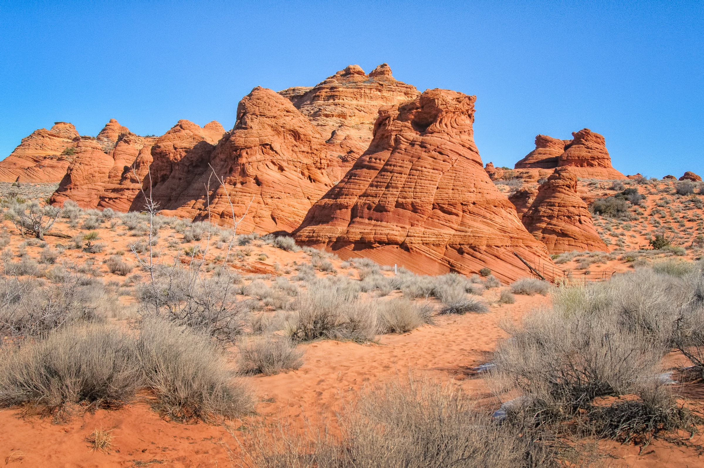 The teepees of Paw Hole are cross-bedded ancient dune fields of the Navajo Sandstone formation,located in Vermillion Cliffs National Monument.