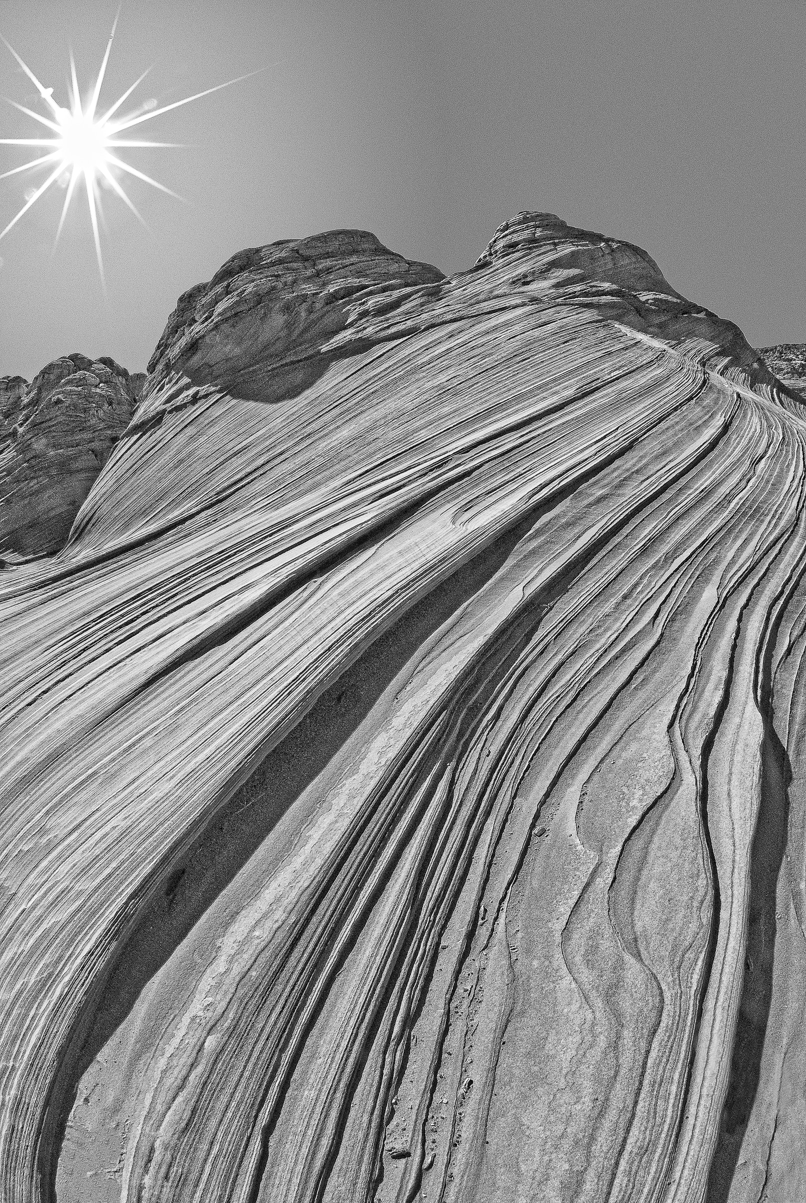Sandstone strata running up the side of a small butte at The Wave in the North Coyote Buttes area of the Vermillion Cliffs National Monument.