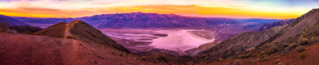 A panotamic view of Badwater Basin and the Panamint Range in the distance from Dante's View, in the Black Mountains, 13 miles southwest of Highway 190 in Death Valley National Park, California.