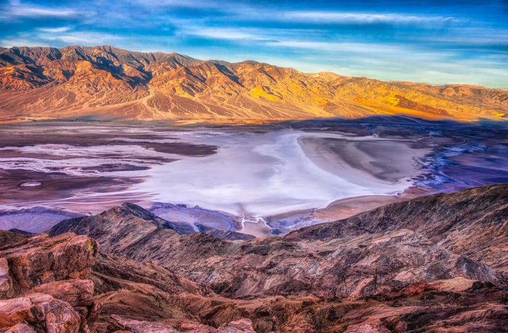 A view of Badwater Basin and the Panamint Mountains in the distance from Dante's View, in the Black Mountains, 13 miles southwest of Highway 190 in Death Valley National Park, California. Notice the alluvial fans in the lower left quadrant.
