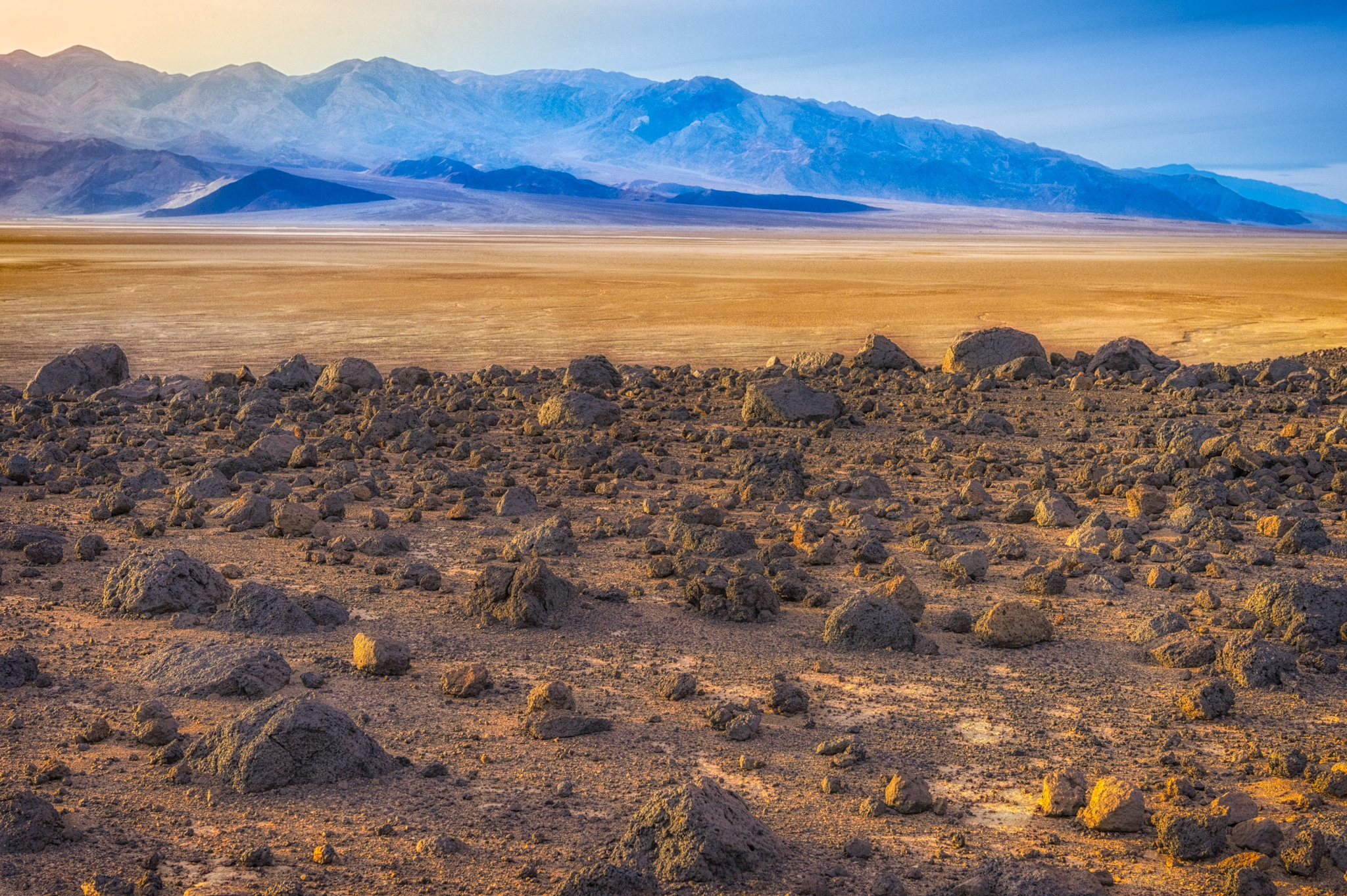 Mars Hill and Ventifact Ridge are on the opposite side of Badwater Road from Artist's Drive in Death Valley National Park. Boulders of basalt are strewn over the desert pavement on these two high-point overlooking Badwater Basin.