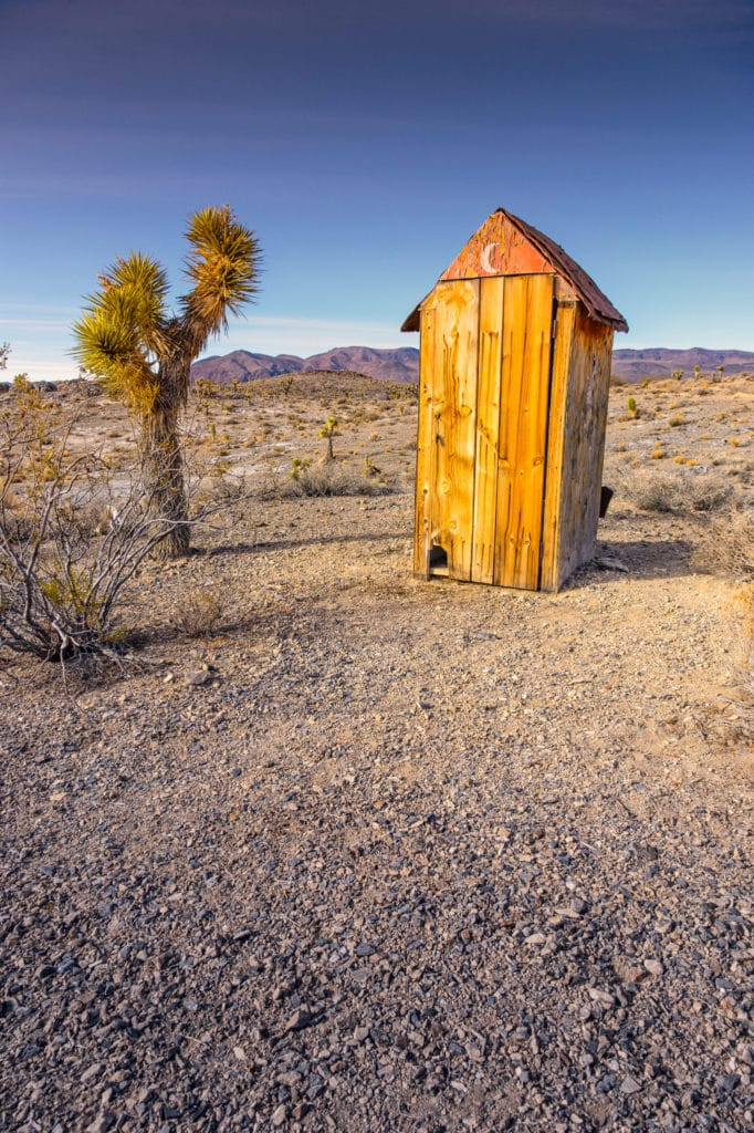 Located along Saline Valley Road, on the way to the Lee Flat Joshua Tree forest, is a boxcar that was part of the BLM's Adopt-a-Cabin program. It is semi-maintained and can be used as an overnight accommodation by travelers exploring this part of Death Valley National Park, California. Along with the cabin is this lonely, but functional, outhouse.