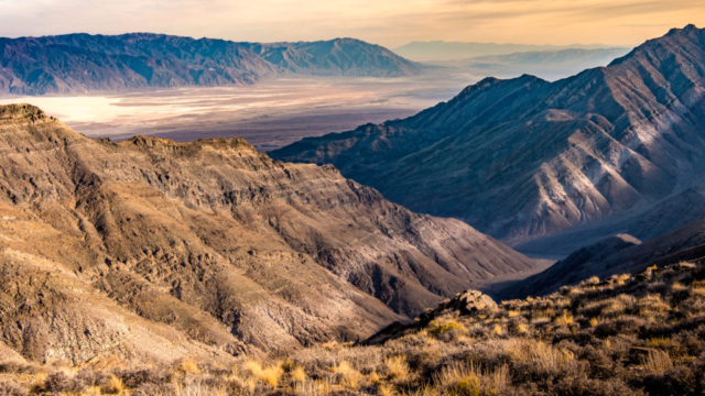 This view from Aguereberry Point, accessible by a dirt road off Emigrant Canyon Road in Death Valley National Park, out across Death Valley and Badwater Basin to the Black Mountains to the south