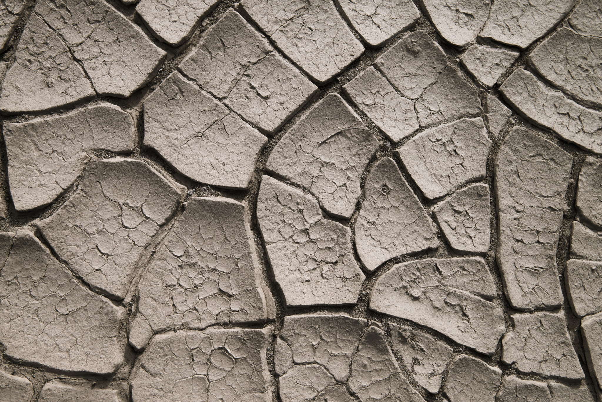 These cracked mudflats are visible along a dirt road that heads west from the airstrip at Stovepipe Wells in Death Valley National Park, California.