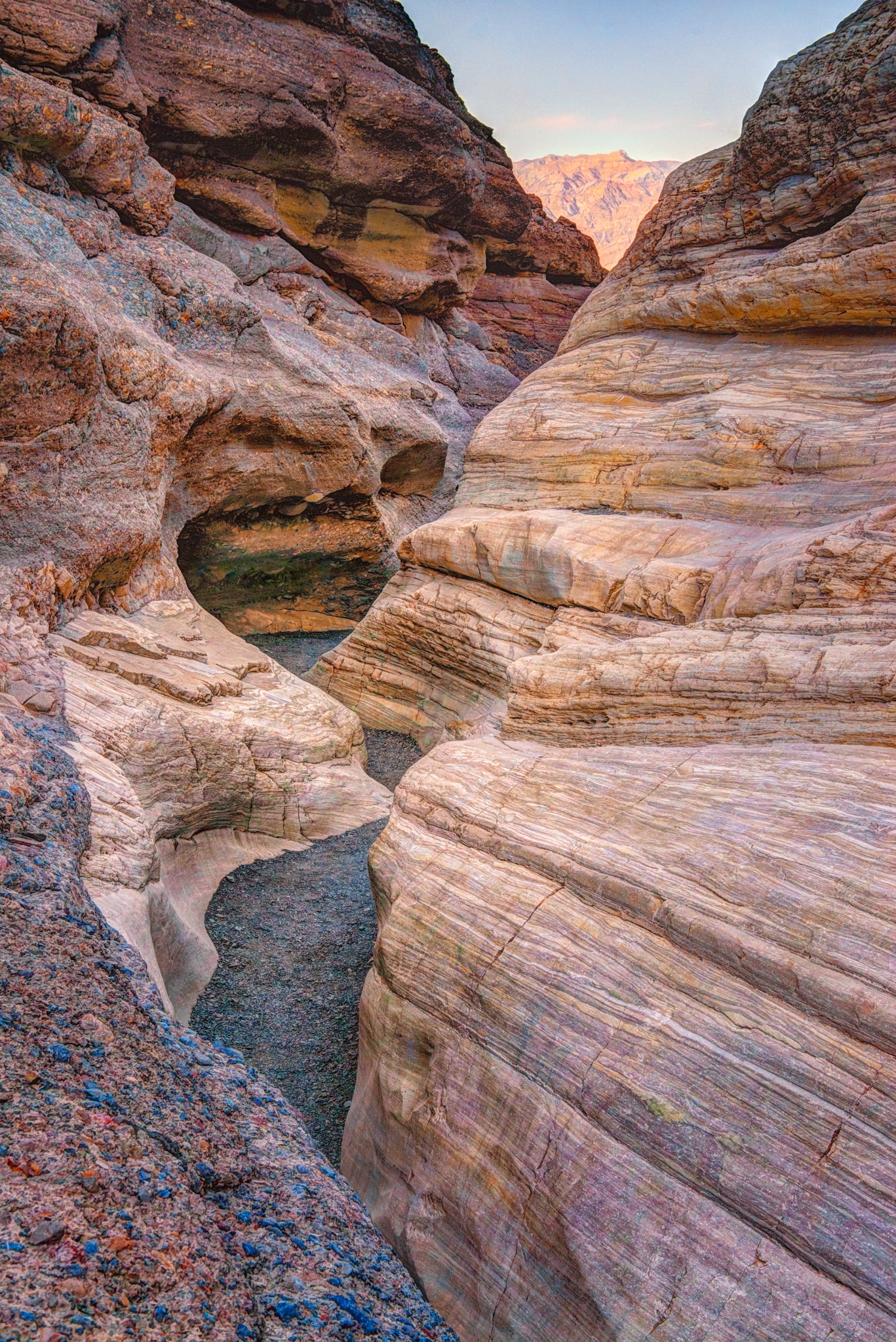 Looking up this wineglass-type canyon, you can see how water has carved a sinuous path through the Noonday dolomite of Mosaic Canyon, located a short distance up a dirt road just west of Stovepipe Wells in Death Valley National Park, California.