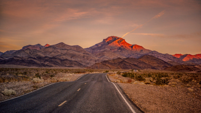 Corkscrew Peak glows orange-red as we head northeast on Daylight Pass Road toward Rhyolite Ghost Town, which is just outside the boundary of Death Valley National Park near Beatty, Nevada.