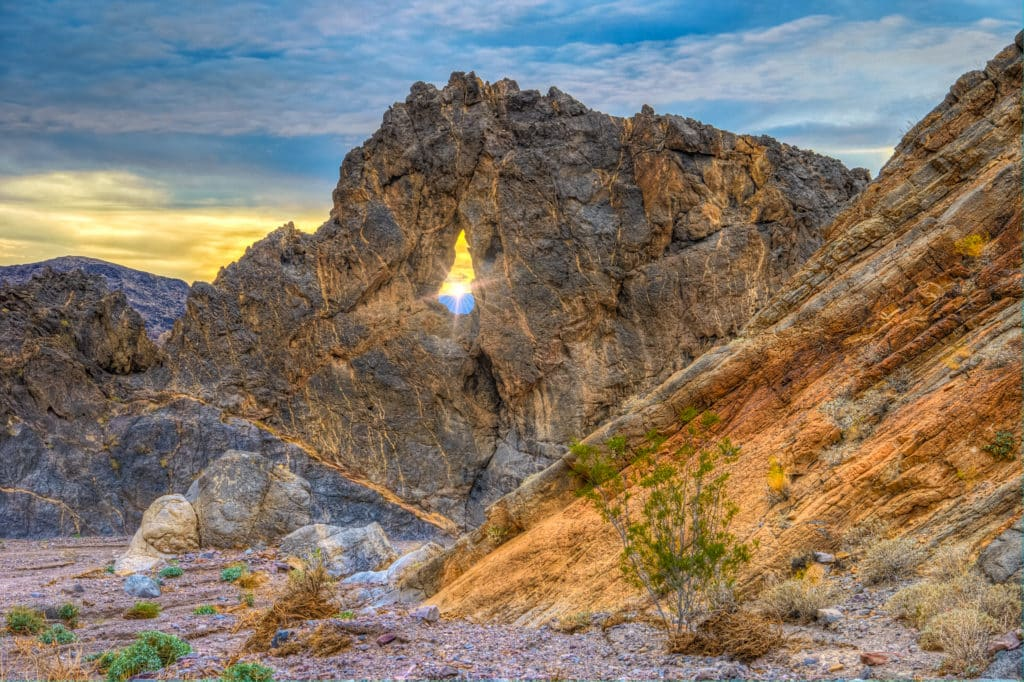 The Eye of the Needle (sometimes called Needle's Eye) is a weathered out keyhole-shaped window located about 5 miles up Echo Canyon Road, which follows an alluvial up and into Echo Canyon, in Death Valley National Park.