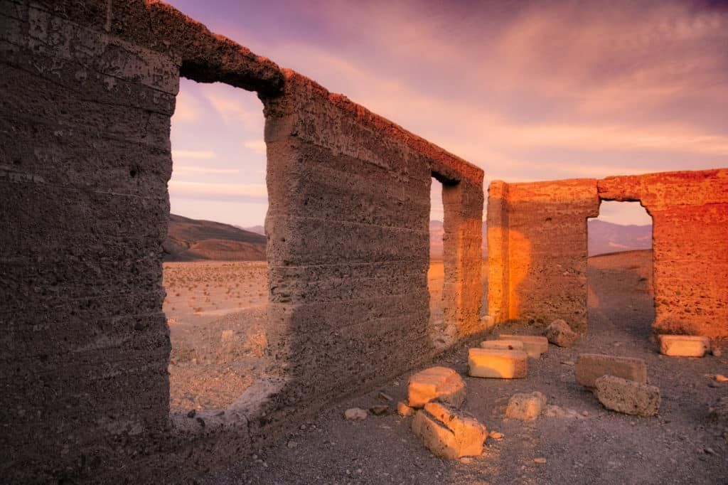 The morning sun illuminates the last reamining walls of the Ashford Mill ruins, located just off Badwater Road in Death Valley National Park.