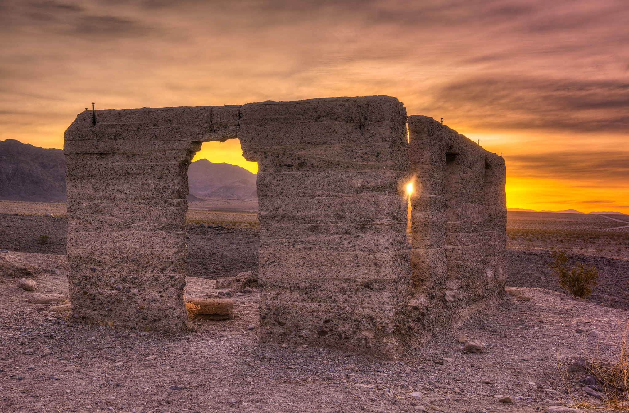 The morning sun shines through the last reamining walls of the Ashford Mill ruins, located just off Badwater Road in Death Valley National Park.