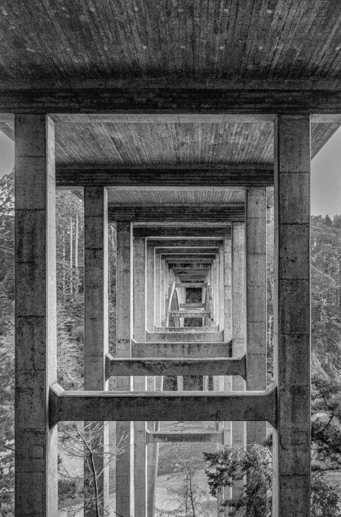 This black-and-white view of retreating squares was taken from beneath the graceful arch of the Russian Gulch Bridge, also known as the Frederick W. Panhorst Bridge, spans the Russian Gulch Creek in Russian Gulch State Park, Mendocino County, California, California's Pacific Coast
