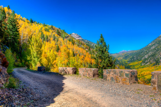 This is one of several barriers built along Old Lime Creek road by the Civilian Conservation Corp. This road winds along Lime Creek and takes you through breathtaking fall scenery.