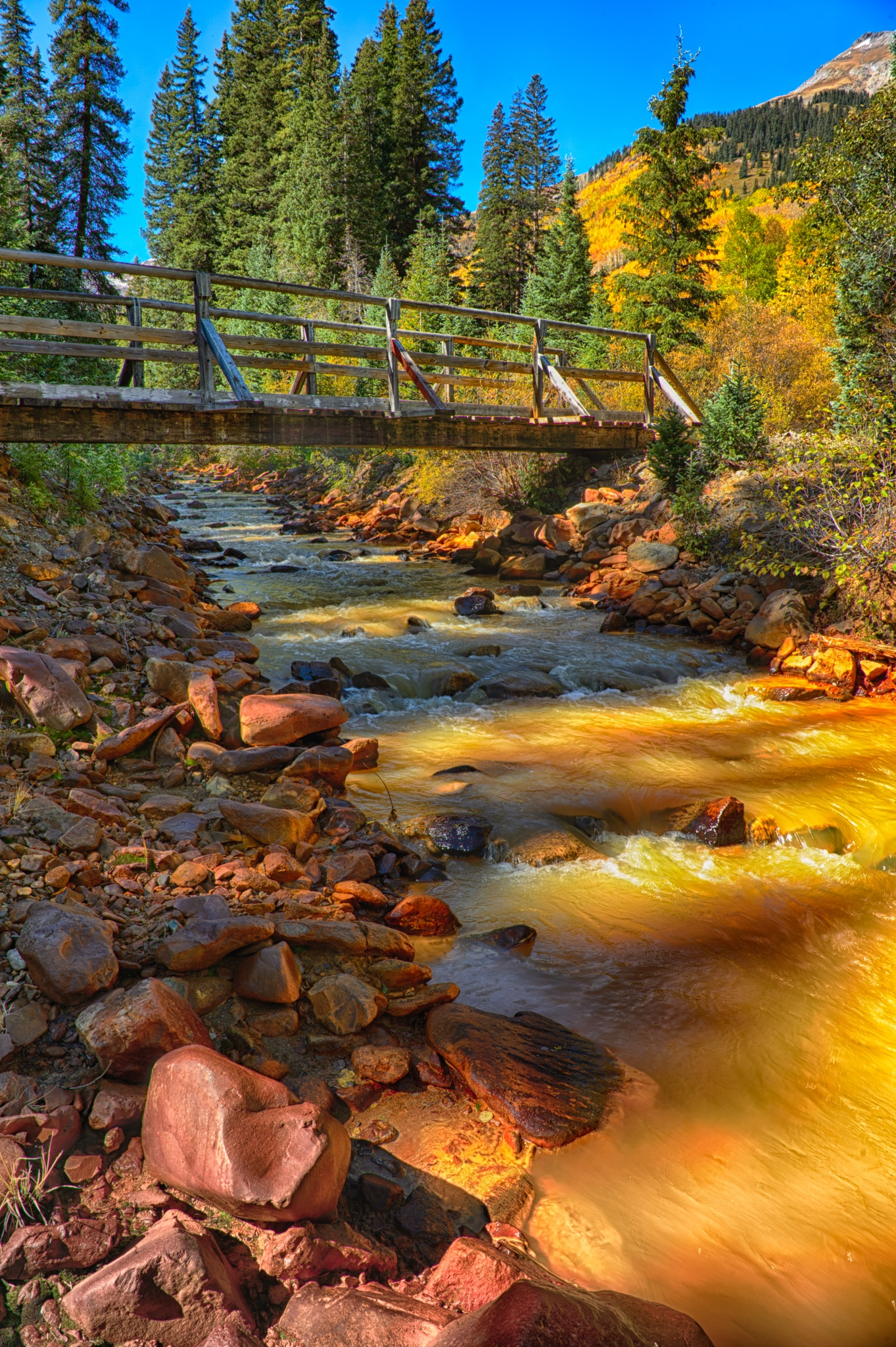 This footbridge crosses Red Mountain Creek and is located near the Ironton Townsite off Highway 550 between Ouray and Silverton, Colorado.