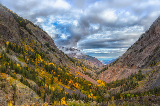 A view north up the valley of the Uncompahgre River as it flows alongside US 550 as it heads to Ouray, Colorado.. Notice: No guardrails!