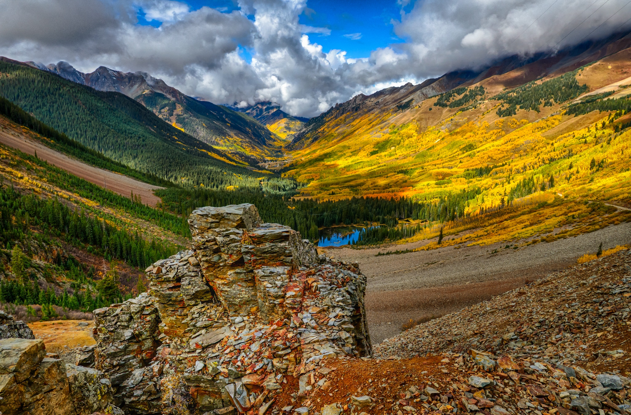A view down the Howard Fork Valley to Ophir from high up Ophir Pass Road that runs between Highway 550 and Telluride, Colorado.