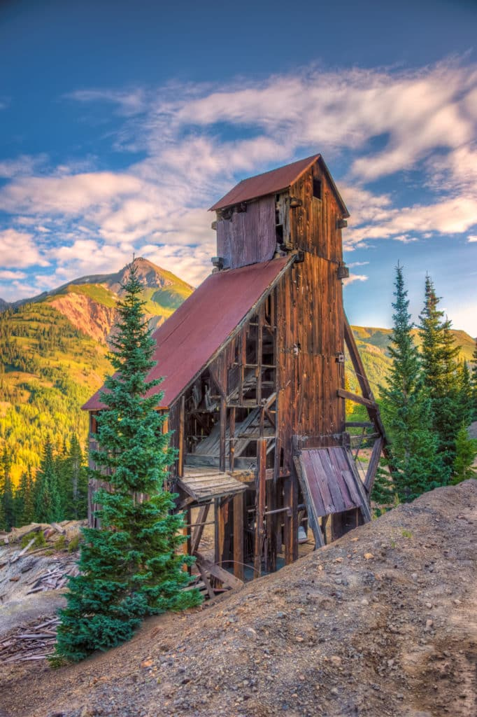 An early morning view of the Yankee Girl Mine headframe viewed from Ouray County Road 31 near Ouray, Colorado.