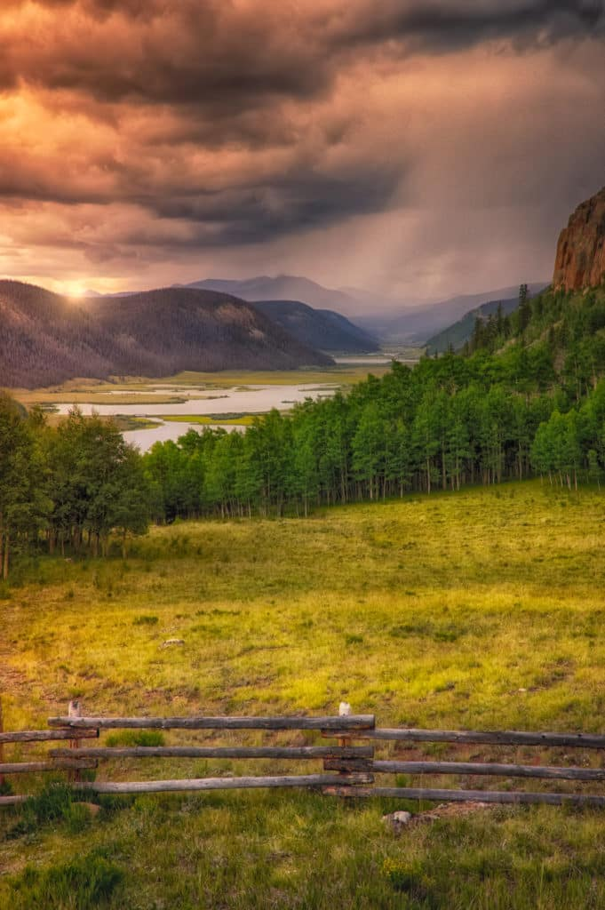 A storm approaches Troutvale Reservoir and Brown Lakes as seen from an overlook on Colorado Highway 149 between Creede to the south and Lake City to the north .