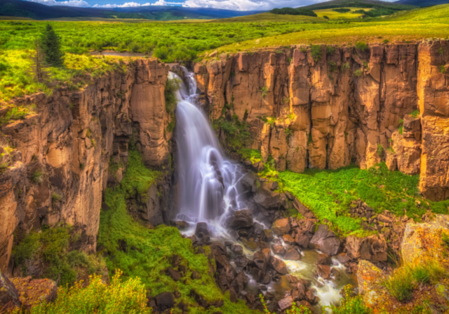 One of the most photographed waterfalls in Colorado, North Clear Creek Falls on FS 510 off CO 149 tumbles over the edge of welded tuff ejected from the San Luis Caldera complex.