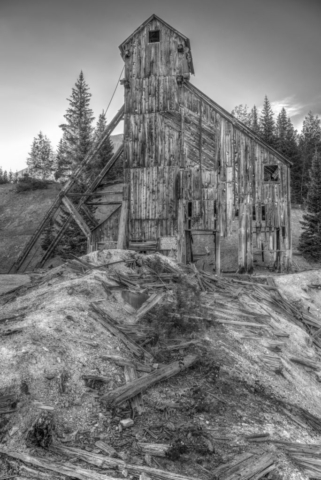 An early morning view in black and white of the Yankee Girl Mine headframe viewed from Ouray County Road 31 near Ouray, Colorado.