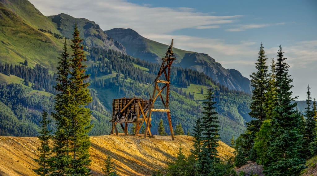 Behind the Yankee Girl Mine headframe on CR 31, south of Ouray, Colorado, is a headframe from what may be the Wilde Mine.