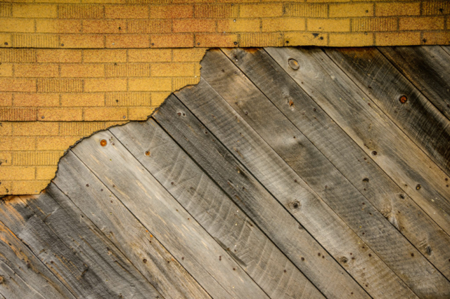 This is a close-up view of old wood and other materials covering the exterior of a structure located in the Animas Forks townsite, northest of Silverton, Colorado, on San Juan County Road 2 near the Alpine Loop.