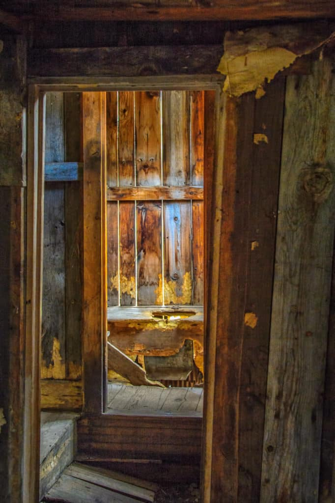 This one-hole outhouse is attached to an abandoned house located in Animas Forks ghost town, off San Juan County Road 2 near the Alpine Loop in Colorado.