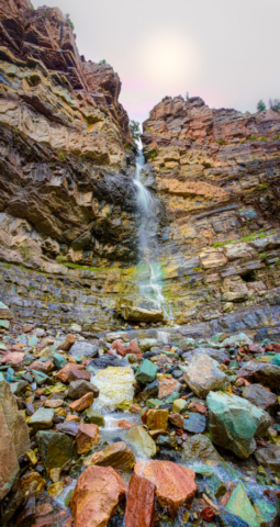 Cascade Falls in Ouray, Colorado, is roughly 160 feet high. Its volume varies with the seasons. Spring brings the highest volume of water, but monsoon rains cause an increase in the flow during the late summer months. The waterfall is fed by Cascade Creek.