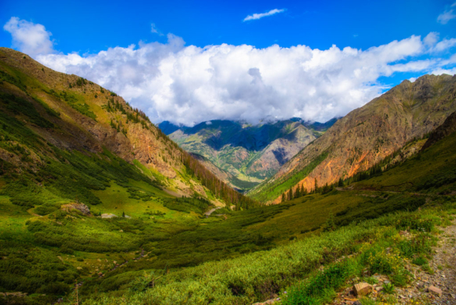 A wreath of clouds hides the tops of the mountains , looking northwest down Stony Pass Road (FS 520), near Silverton, Colorado.