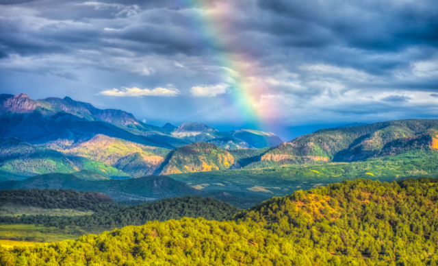 A rainbow paints the sky after a thunderstorm, as seen from Ridgway State Park near Ridgway, Colorado.