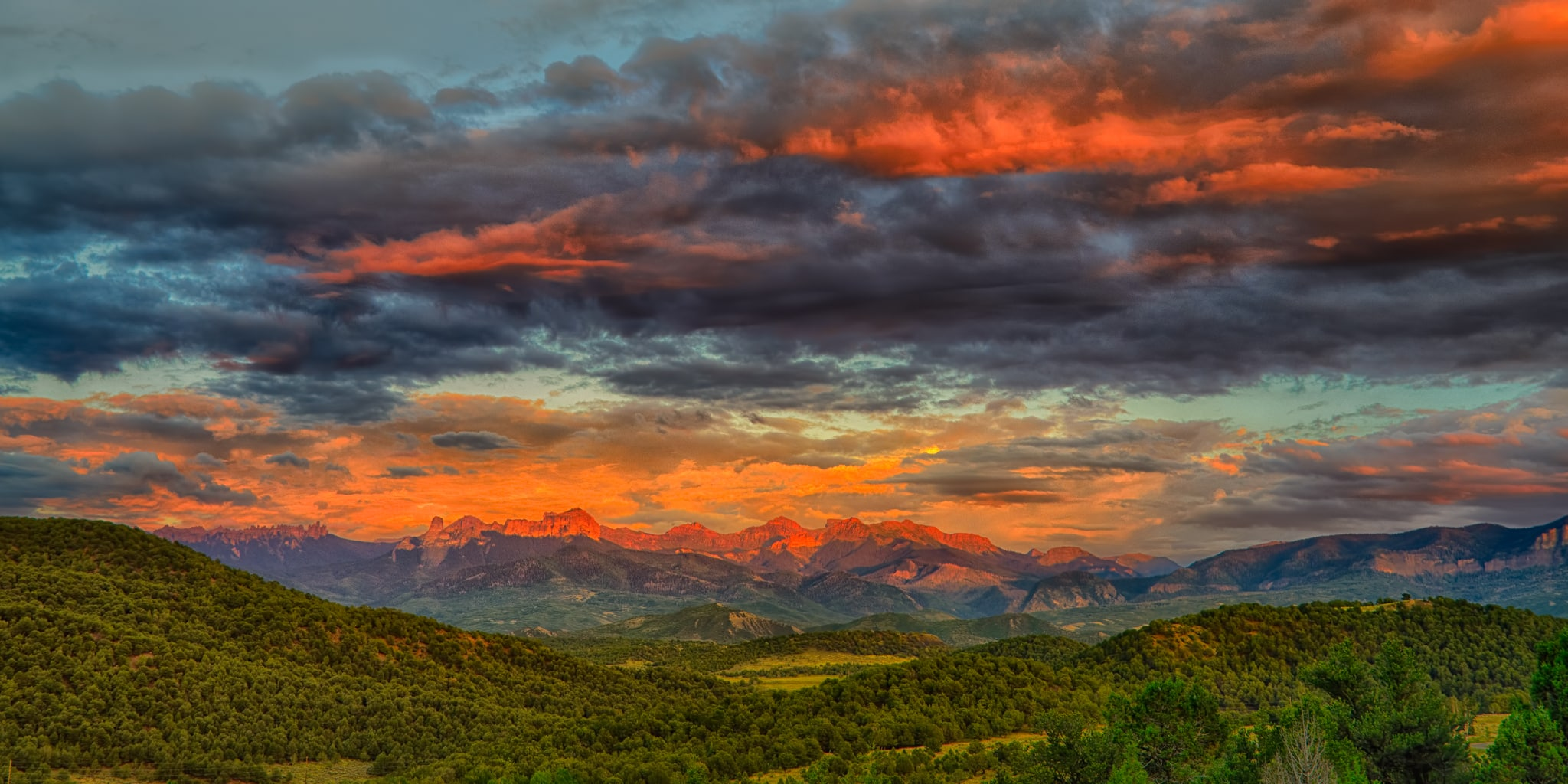 The last bit of light turns the Comarron Mountains red. Taken from Ridgway State Park near Ridgway, Colorado.