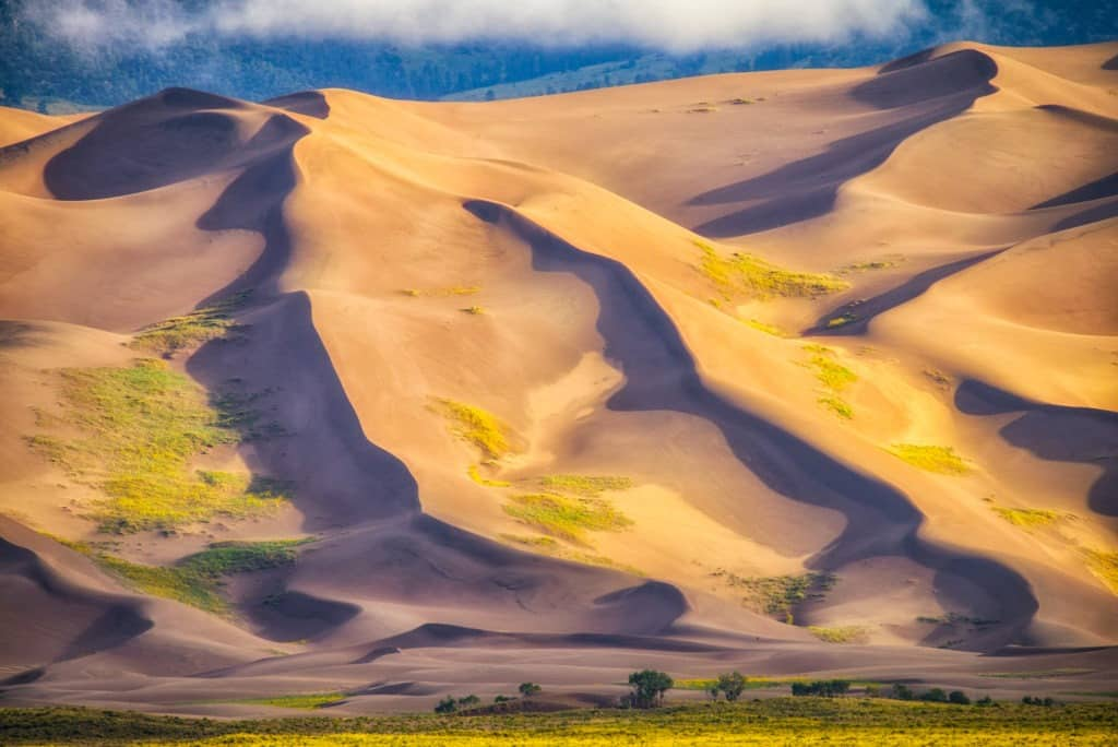 The clouds have just cleared the Great Sand Dunes, allowing the morning light to enhance their texture.