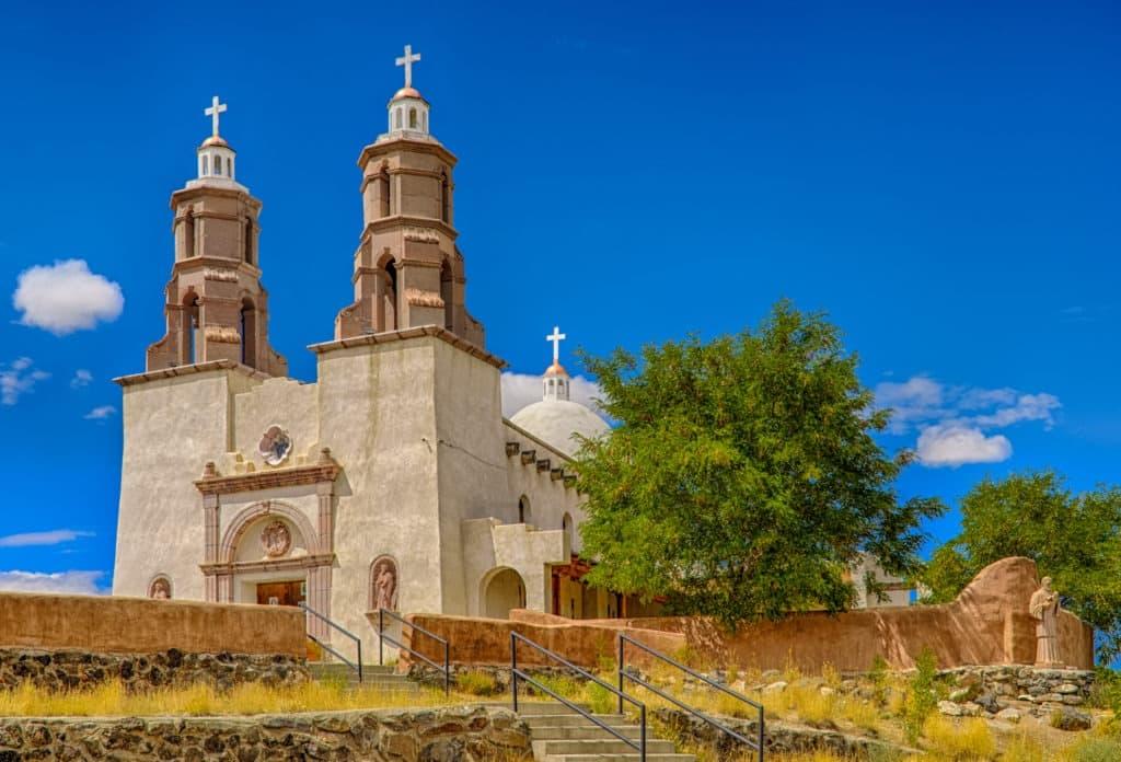 This is a view of the Shrine of the Stations of the Cross (La Capilla de Todos Los Santos) and the enclosed garden, located above San Luis, Colorado, on the Hill of Piety and Mercy (La Mesa de la Piedad y de la Misericordia).