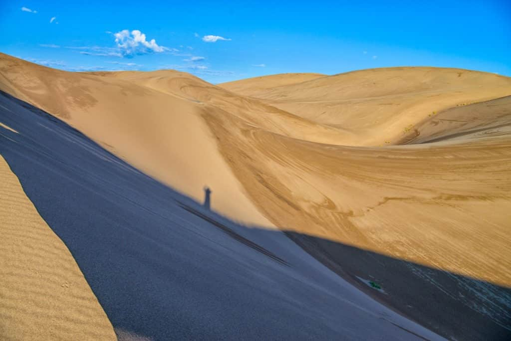 Even the hiker's shadow is celebrating making it to the top of the great dune in Great Sand Dunes National Park and Preserve near Alamosa, Colorado.