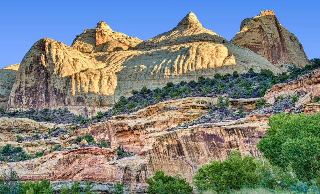The first light of day shines across Navajo Dome in Capitol Reef National Park.