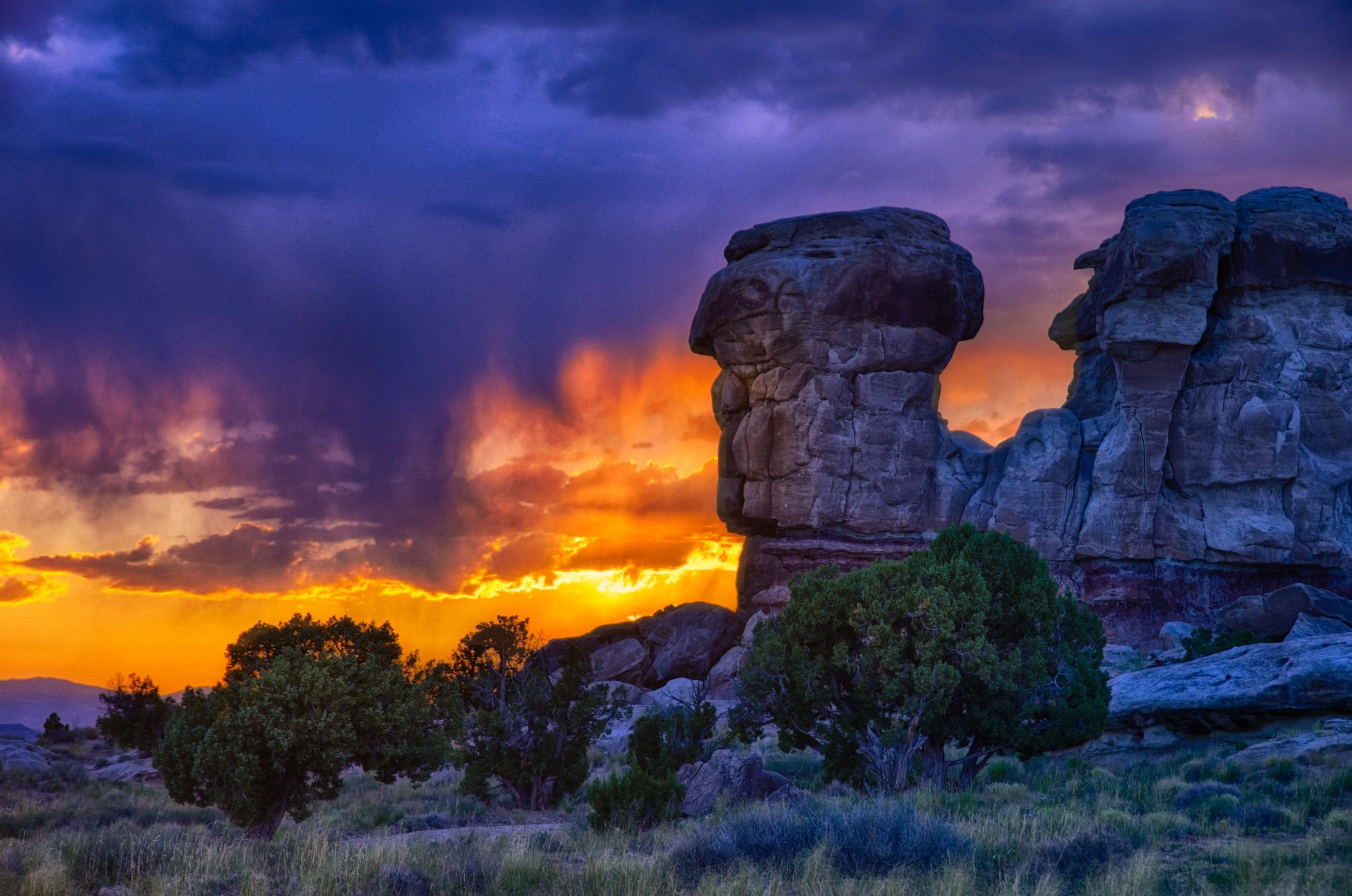 Sunset behind rock outcrop along Caineville Wash Road near Capitol Reef National Park. The projecting rock looked amazingly like a Mayan carving of a skull.