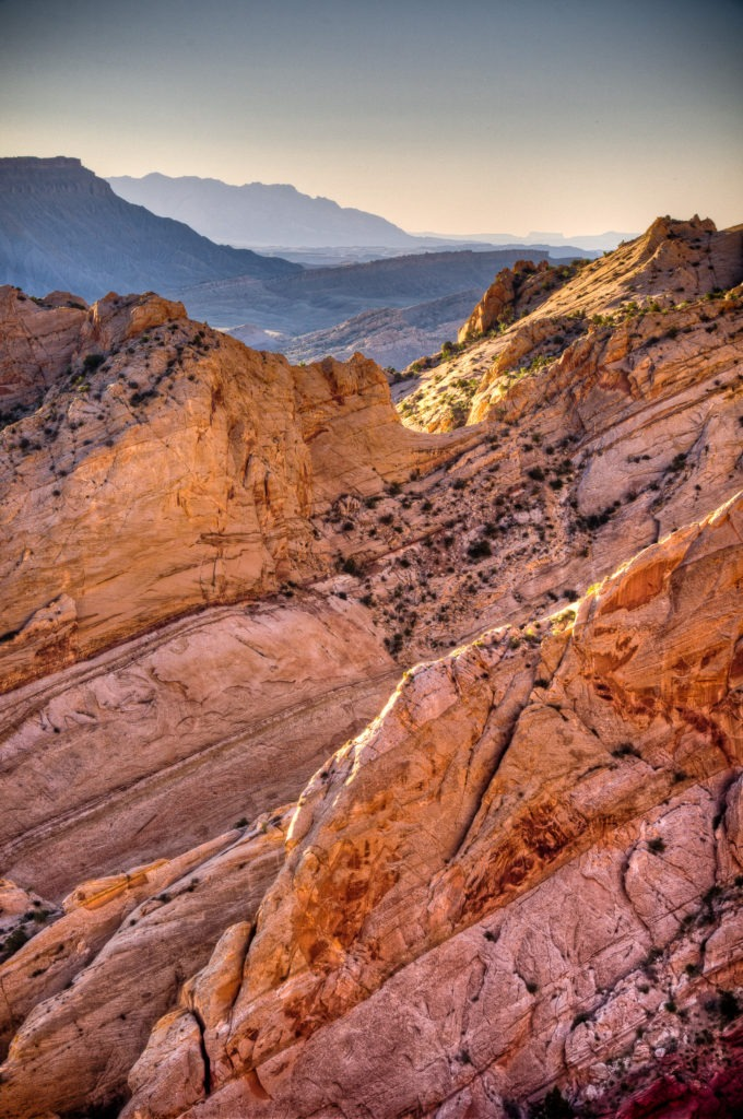 Looking southeast through uptilted layers of the Waterpocket Fold along Burr Trail in Capitol Reef National Park, Utah.