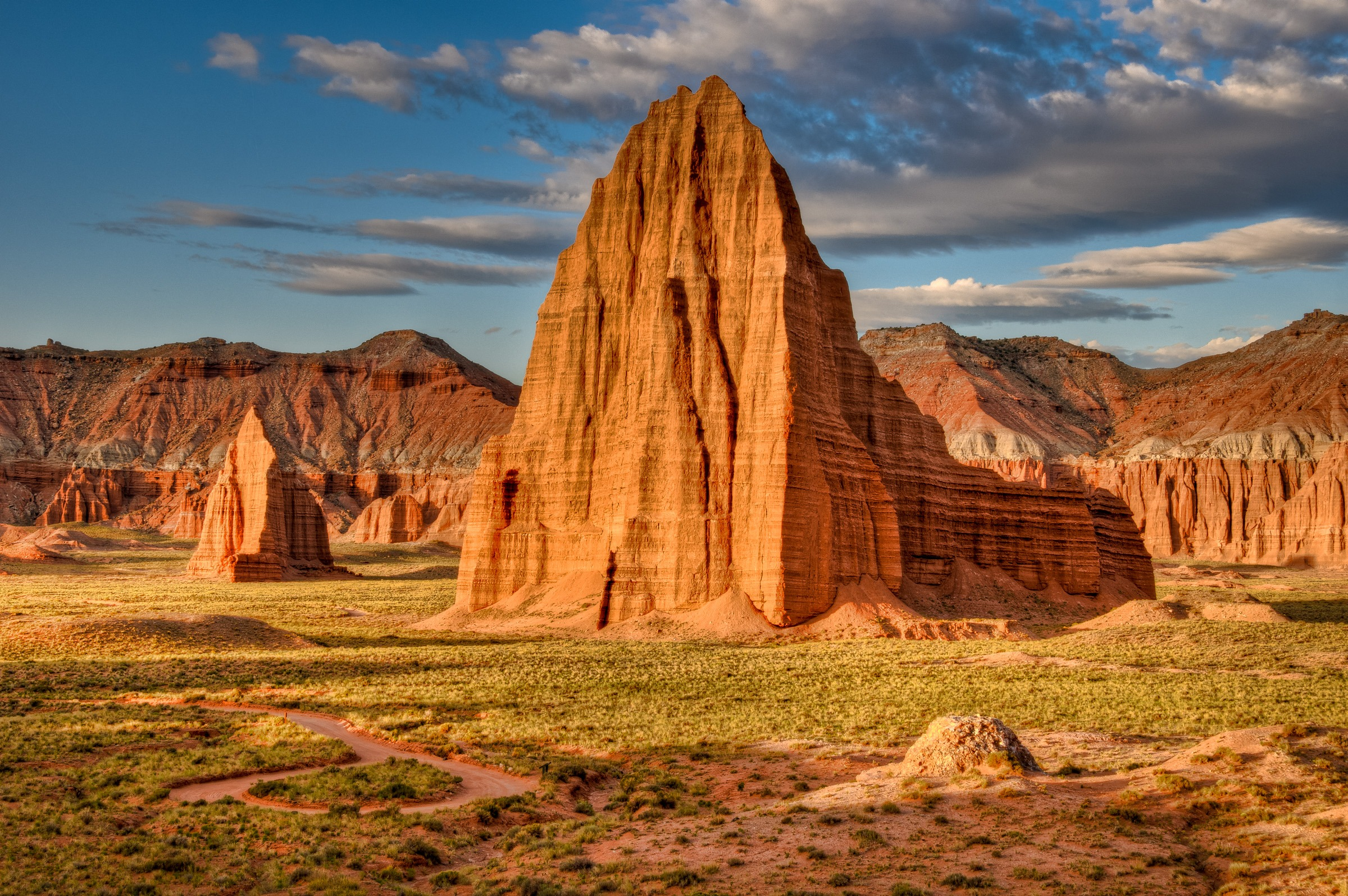 Temples of the Sun and Moon in the Cathedral Valley section of Capitol Reef National Park. The Temple of the Sun is the big one in the center. Also visible below and to the right is the dome of Glass Mountain.