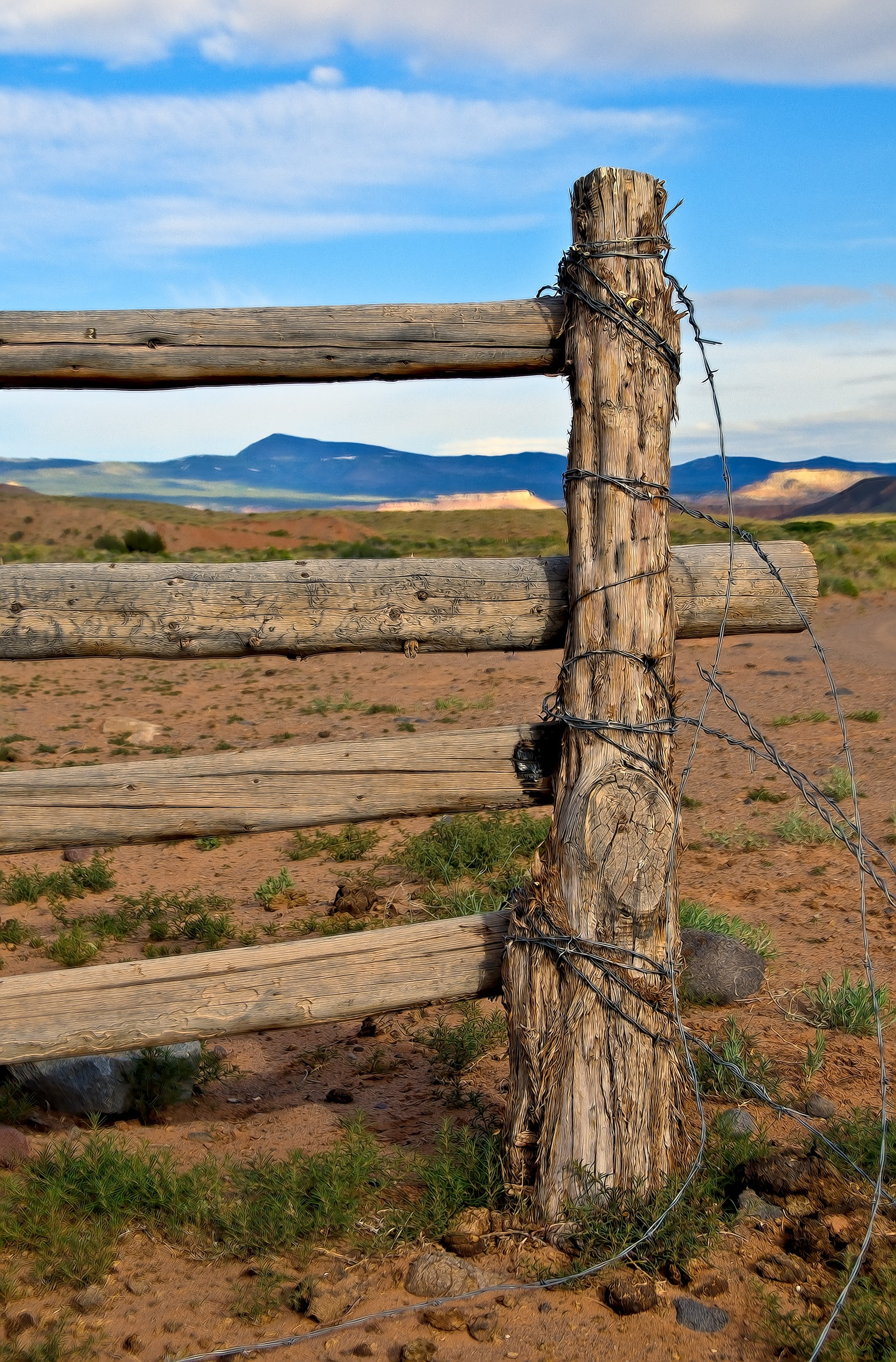 Barbed wire post and rail fence can be seen along Cathedral Road in the Cathedral Valley area of Capitol Reef National Park, Utah.