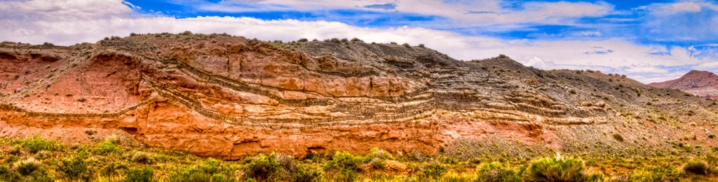Numerous intrusions of lava between layers of sandstone in the Catheral Valley section of Capitol Reef National Park.