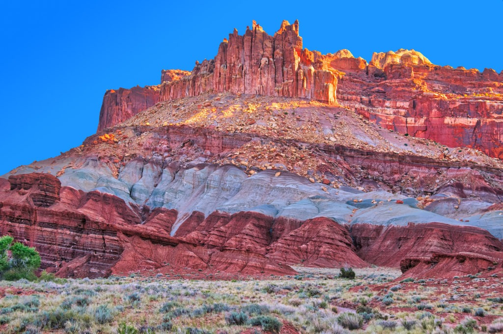 The Castle, near the Capitol Reef National Park Visitor's Center, glows in the morning light.