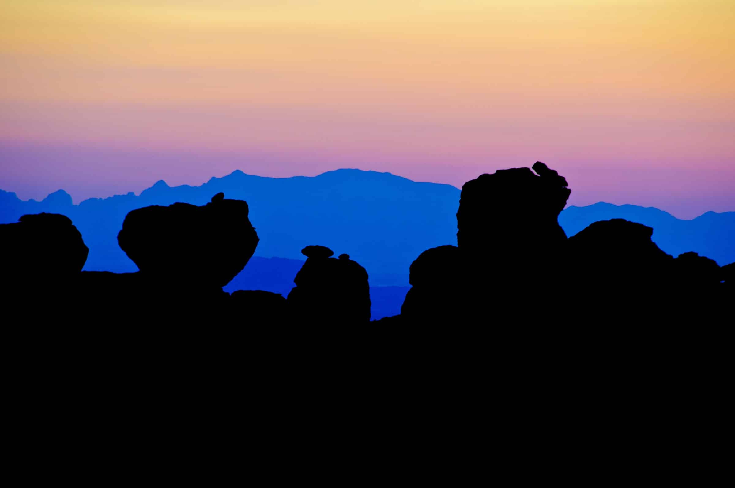 Columns of Rhyolite Canyon Tuff silhouetted by twilight color in Chiricahua National Monument.