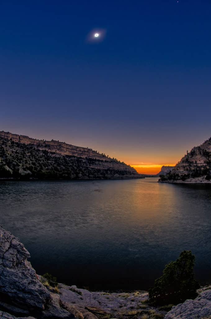 A false sunset at totality over Lake Guernsey in Guernsey State Park in Wyoming.