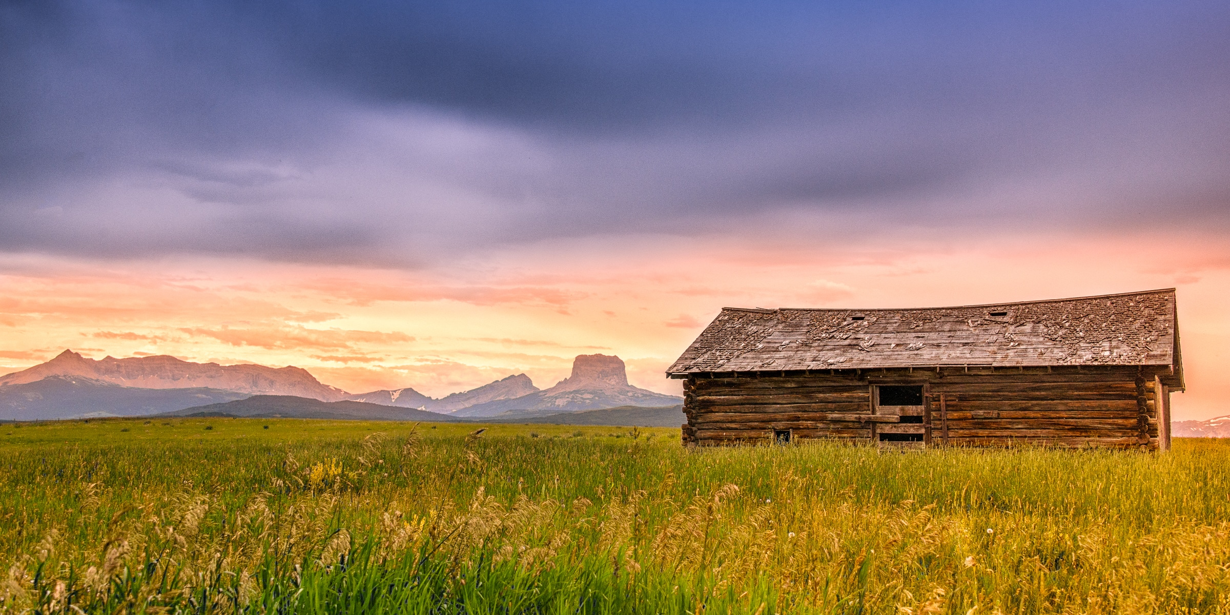 This log barn sits in the middle of a prarie, just east of theGlacier National Park boundary on Highway 89 between Babb and Conway, Montana. Montana Summer Landscapes