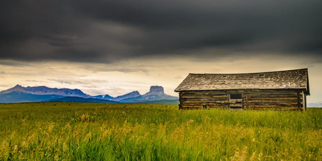 This log barn sits in the middle of a prarie, just east of Glacier National Park boundary on Highway 89 between Babb and Conway, Montana. Montana Summer Landscapes