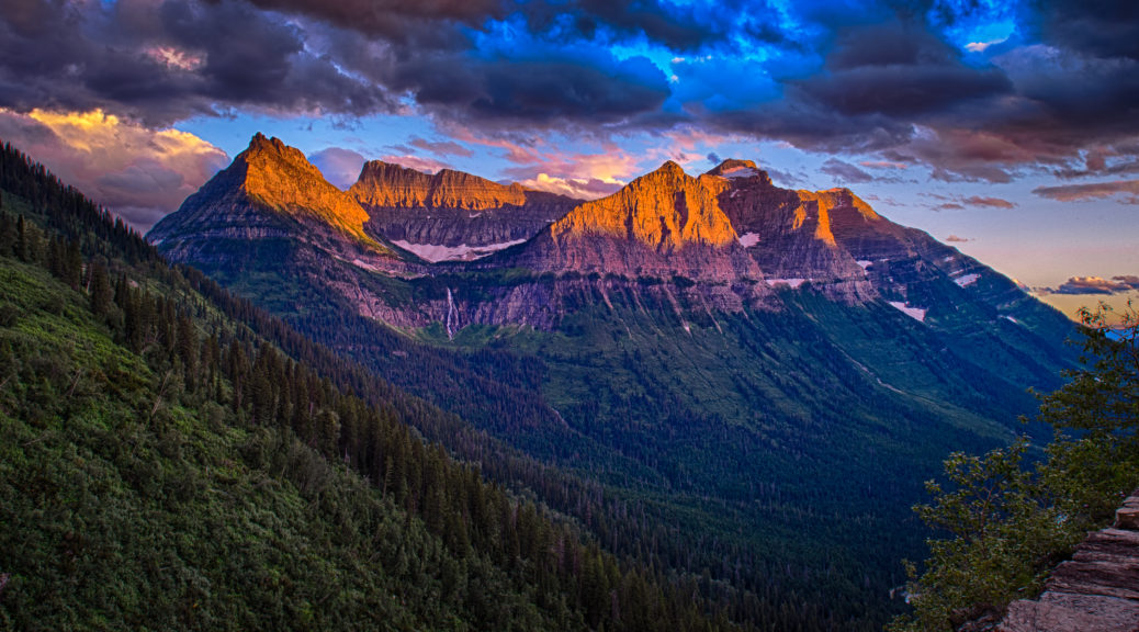 The setting sun lights up peaks along the Going to the Sun Road in Glacier National Park in Montana.