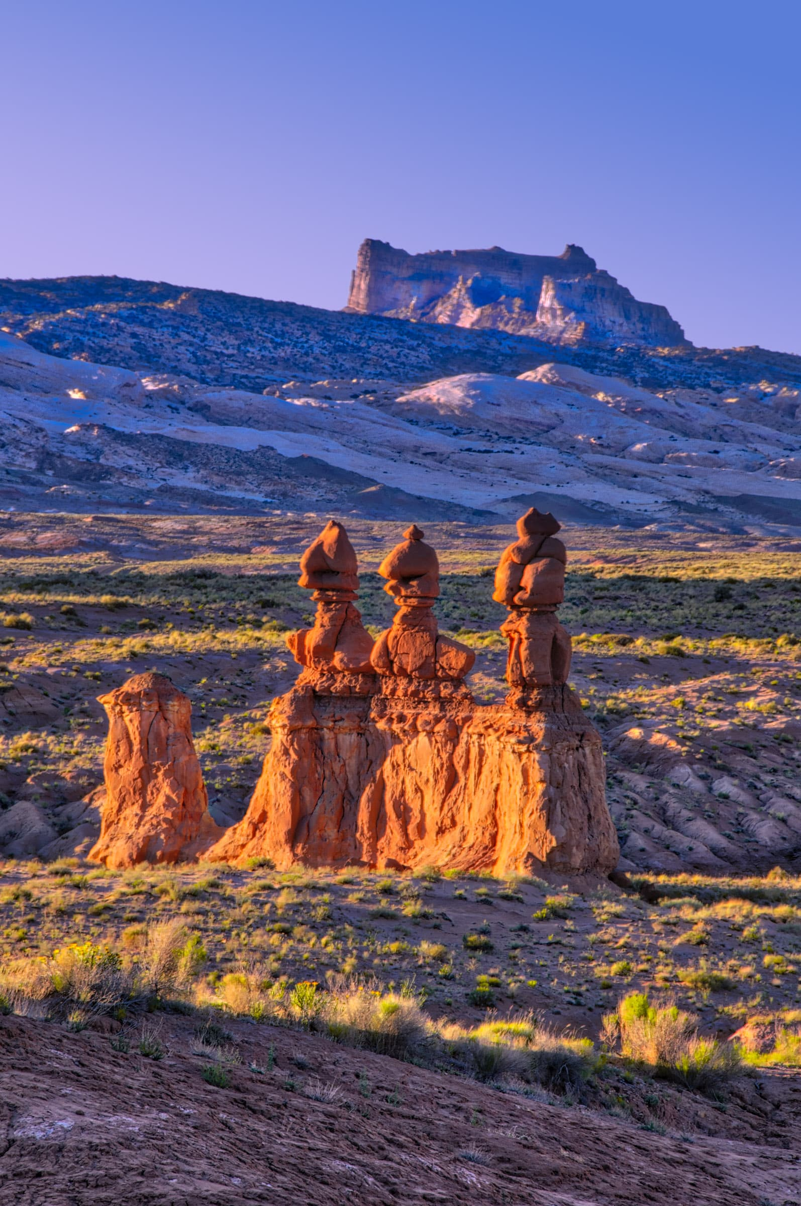 The late afternoon sun warms the formation known as The Judges in Goblin Valley State Park near Hanksville, Utah.